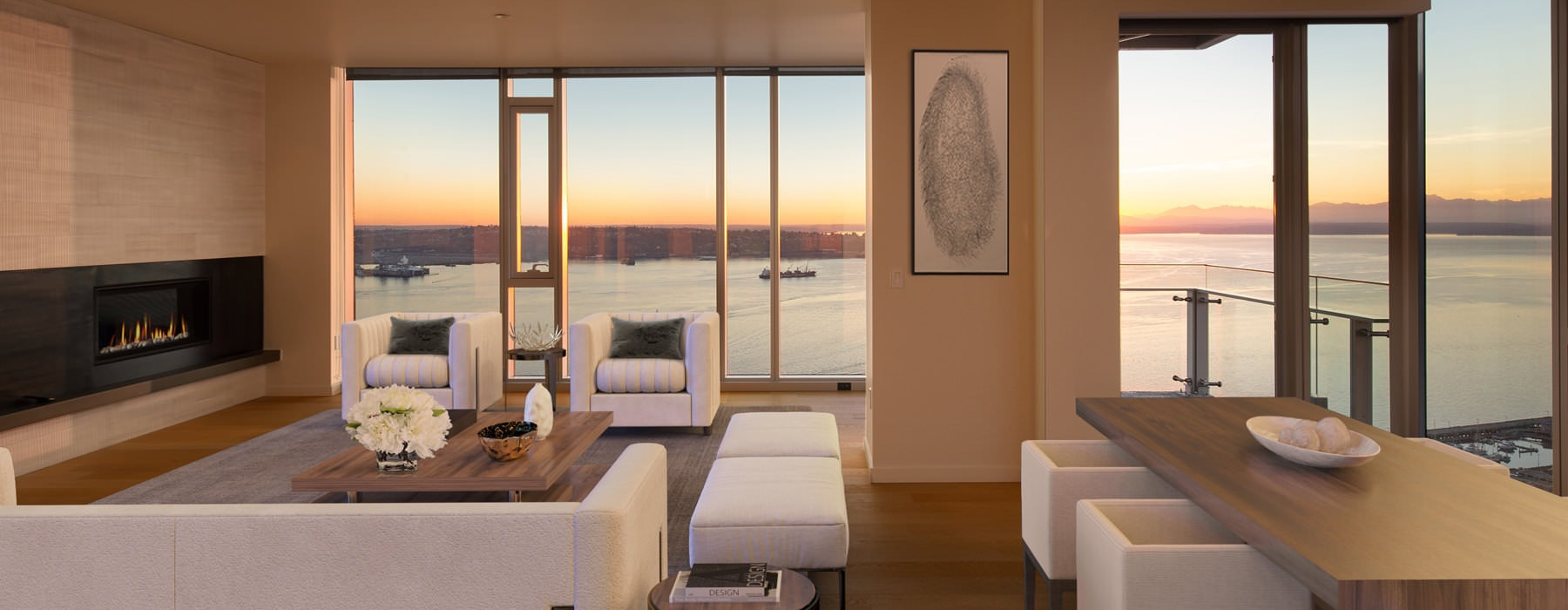 penthouse interior with floor-to-ceiling windows and view of the sunset across the bay